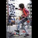 Akira street DJ and artist painting a girl