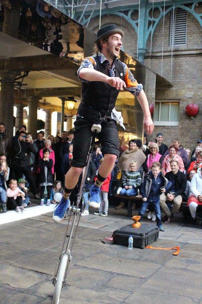 Corey London street performer on unicycle