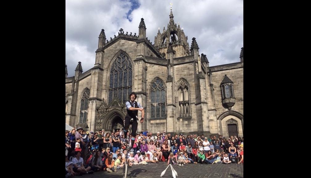 Corey unicyclist with crowd