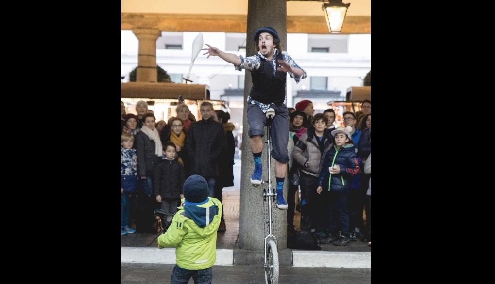 Corey juggling on a unicycle