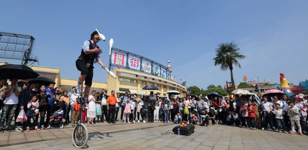 Corey juggling unicyclist performer