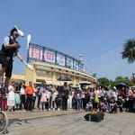 Corey juggling unicyclist performer