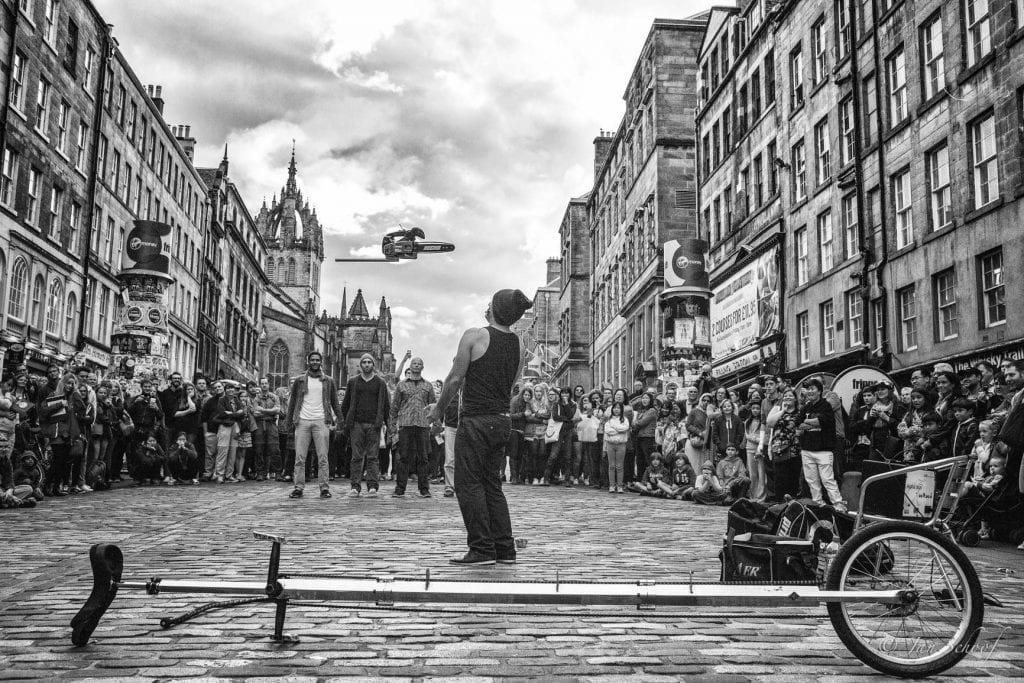 black and white photo of street show