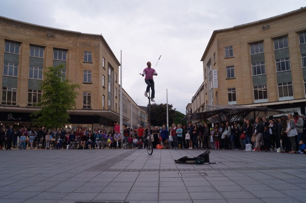 knife juggling on a unicycle